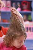 Little girl haircut stock photos