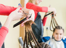 Little girl in hairdresser salon Stock Photo
