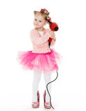 Little girl with hairdryer. Royalty Free Stock Image