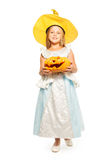 Little girl with Halloween carved pumpkin Stock Images