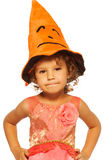 Little girl in Halloween costume hat Stock Images