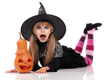 Little girl in halloween costume. Portrait of little girl in black hat with pumpkin isolated on white background stock photo