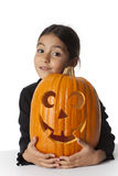 Little girl with a Halloween pumkin Stock Image