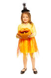 Little girl with Halloween pumpkin and costume Royalty Free Stock Photo