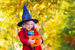 Little girl on Halloween trick or treat Royalty Free Stock Image