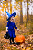 Little girl on Halloween trick or treat Stock Images