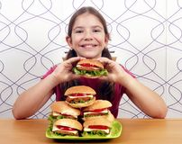 Little girl with hamburgers Stock Photography