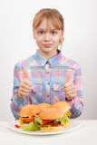 Little girl with hamburgers showing thumbs up Royalty Free Stock Images