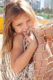 Little girl in hammock. Beautiful little girl sitting in hammock and smiling Royalty Free Stock Photos