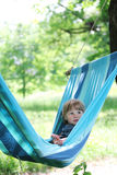Little girl on a hammock Stock Images