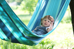 Little girl on a hammock Stock Photos