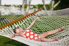 Little girl in hammock stock images