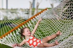 Little girl in hammock stock image