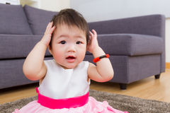 Little girl hand cover ear Stock Photo