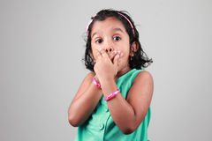 Little girl. With hand cover her mouth royalty free stock photos