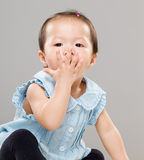 Little girl with hand cover her mouth Stock Photo