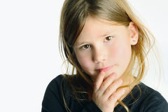 Little girl with hand on face Royalty Free Stock Photography