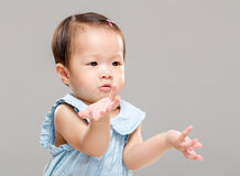 Little girl with hand posture Royalty Free Stock Images