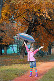 Little girl with hand up in park autumn season Royalty Free Stock Images