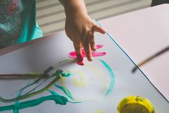 Little girl hand, who is painting with her finger Stock Images