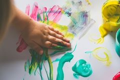 Little girl hand, who is painting with her finger Stock Photography