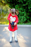 Little girl with handbag in park Royalty Free Stock Images