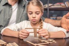Little girl handcrafting Stock Photos