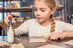 Little girl handcrafting Royalty Free Stock Photography