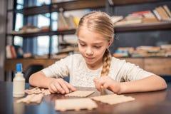 Little girl handcrafting Stock Images