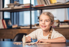 Little girl handcrafting Royalty Free Stock Images