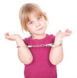 Little girl in handcuffs Stock Photography