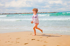 Little girl with handfuls of sand Royalty Free Stock Photography