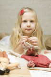 Little girl with handmade toys Royalty Free Stock Photos