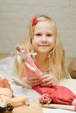 Little girl with handmade toys at home Stock Image