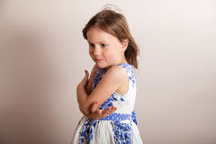 Little girl with hands crossed in front of her Royalty Free Stock Image
