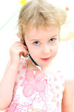 Little girl with hands-free device. Stock Image