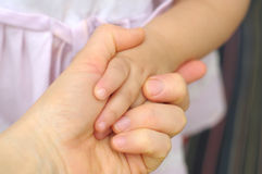 Little girl hands in mums hands Stock Image