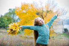 Little girl with hands open. Over autumn background Royalty Free Stock Images
