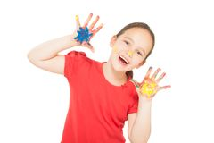 Little girl with hands in the paint Stock Images