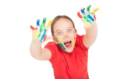 Little girl with hands in the paint Royalty Free Stock Image