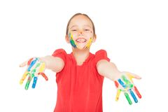 Little girl with hands in the paint Royalty Free Stock Images