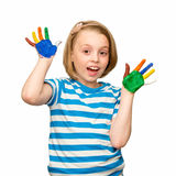 Little girl with hands in the paint. Stock Photo