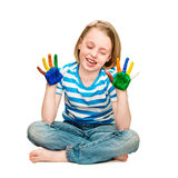 Little girl with hands in the paint. Royalty Free Stock Image