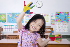 Little Girl with Hands in The Paint Stock Photo