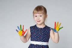 Little girl with hands in paint on white Royalty Free Stock Images