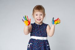 Little girl with hands in paint on white Stock Images