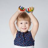 Little girl with hands in paint on white Stock Photography