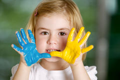 Little girl with hands painted Royalty Free Stock Photography