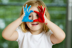 Little girl with hands painted Royalty Free Stock Image