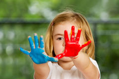 Little girl with hands painted Royalty Free Stock Photo